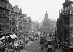 Bigg Market, Newcastle upon Tyne, 1920. The town hall, in the middle, was demolished in 1973. Lost England/Rex/Shutterstock