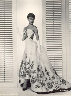 Audrey Hepburn in the movie Sabrina. I honestly think this is one of the most beautiful dresses I have ever seen!