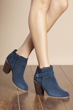Navy suede booties with gorgeous buckle detailing along the ankle