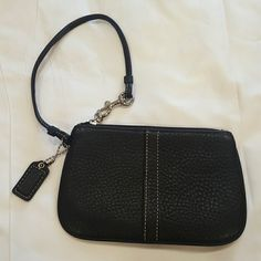 Coach black coin leather wallet wrislet Coach black wallet/wrislet. Very nice leather only used a few times. Measures 6.5x4in. Coach Bags Clutches & Wristlets
