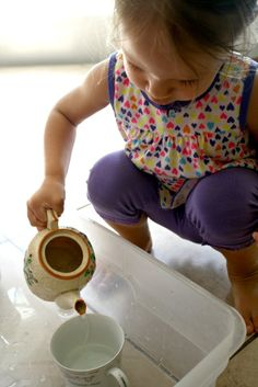 Toddler Pouring Activity...This was a fun activity that both the toddlers and preschoolers liked during our T is for Tea Time theme.