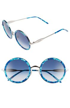 Popping on some blue-tinted sunglasses for a cool look. This pair from Wildfox also has a patterned trim and oversized lenses.