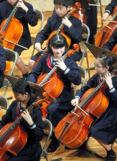 Japanese Princess Aiko (C), daughter of Crown Prince Naruhito and Crown Princess Masako, plays the cello during a regular orchestra concert by the alumni of Gakushuin University in Tokyo on 14 April 2013