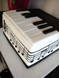 Piano cake.  Could modify this for a marimba for Jake's grad party