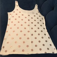 "Victoria's Secret ivory top w/ bronze sequins M Cute VS tank top q/ round bronze sequins making the appearance of polka dots on the front.  25"" from shoulder to hem.  100% cotton.  Worn once ( I have too much stuff!). 💕💞💖 Victoria's Secret Tops Tank Tops"