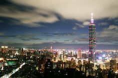 A picture of Taipei's skyline at night, featuring Tapei 101, which was the tallest building in the world until 2007.