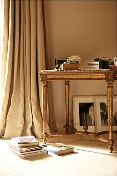 camilla freeman-topper's desk ( puddle at the base of curtain a must!)