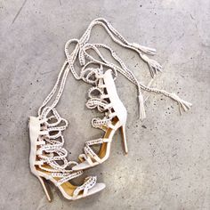 Guiseppe Zanotti withe gladiator heel sandal. Silver chain knot with tassels on. Great dress up shoes for upcoming summer time! Please call (949) 715-0004 for all inquiries.  #couture #designer #runway #consignment #luxuryconsignment #lagunabeach #fashion #style #luxury #stylish #luxuryshopping #shoes #heels #outfit #purse #handbag #jewelry #shopping #glam #readytowear #guiseppezanotti #OC #orangecounty #LA #losangeles #giuseppezanottiheelssilver