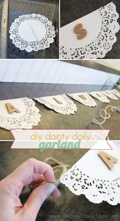 Doily garland. Seems a bit too country but I like the idea. Just needs some of the twang taken out some how. Maybe little bunting flags in white??