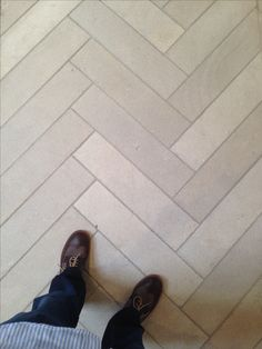 """Iron blasted Dalle de France """"Branly"""" limestone floors in a large herringbone pattern (~4x16) in the wine cellar ($15-17psf. Exquisite Surfaces"""