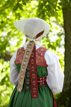 Sweden.Two neighboring communities of Vingåker and Österåker. Province of Södermanland or Sörmland. These two communities have very similar costumes. This type of dress is called Livkjol in Swedish. This one is Vingåker. See link for blog.
