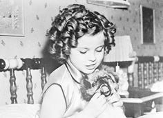 Shirley Temple and her dog Ching Ching, 1936.
