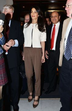 Amal completed an ivory cardigan with brown luxe trousers and neutral pointed pumps in Athens, Greece.