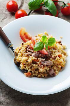Cooked sardinain pasta fregola with tomato and sausage by Oxana Denezhkina - Photo 110182093 - 500px