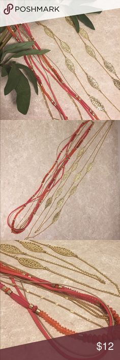 Bundle 2 long layered necklaces gold coral pink This is a bundle of two long layered necklaces, one gold with leaf type charms, second coral pink with leather cords and beaded layer, see pictures for details. Good condition minor wear. Be sure and check out other items in closet and bundle to receive discounts. Jewelry Necklaces