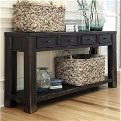 Gavelston Distressed Black Sofa Table with 4 Drawers & Shelf by Signature Design by Ashley at Del Sol Furniture
