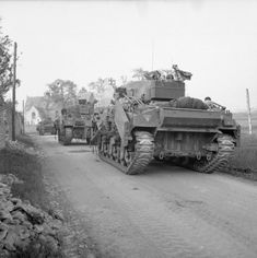 Sherman Crab flail tanks enter Escoville as they move up during Operation 'Goodwood', 18 July 1944.