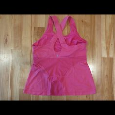 Lululemon Tank In good condition!  Adorable mesh detail on the back. There is a small amount of pilling under the arms which is not noticeable when worn. Size 10, fits like an 8. Has a built in bra, but does not have pads.  Reasonable offers welcome. lululemon athletica Tops Tank Tops