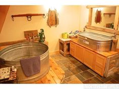 Bathroom - stock tank tub and sink, how awesome is this? I'm doing this in our house we build, will go with my country theme and will be tons cheaper then buying a soaking tub! and its neat as all get out! Silo House, Stock Tank, Rustic Bathrooms, Rustic Bathtubs, Dream Bathrooms, Home Remodeling, House Plans, Sweet Home, New Homes