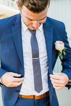 Groom wearing blue suit with patterned tie and blush rose buttonhole | Curly Tree Photography | See more: http://theweddingplaybook.com/elegant-boho-wedding-by-the-beach/                                                                                                                                                                                 More