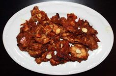 Sizzling hot Indian pepper chicken.