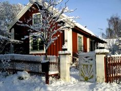 A Sweden Christmas -Swedish red cottage in snow. Photo: Tore Larsson