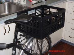 a collapsible plastic bin as a bike trunk