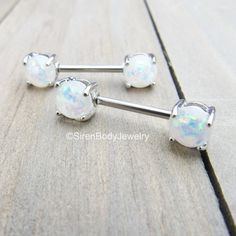 Creamy white opals speckled with pink and green are featured in these gorgeous nipple piercing barbells! Forward facing for the most aesthetically pleasing view, these opal nipple rings are perfect for healed nipple piercings. SirenBodyJewelry.etsy.com