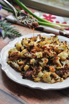 Creamy oven-roasted cauliflower that's delicious by itself, but even more intriguing with a savory soy-ginger sauce. Vegan and gluten-free friendly. cauliflower Roasted Cauliflower With Soy-Ginger Sauce (Vegan) Vegetable Recipes, Vegetarian Recipes, Healthy Recipes, Vegetable Appetizers, Soy Ginger Sauce, Soy Sauce, Tahini Sauce, Oven Roasted Cauliflower, Vegan Cauliflower