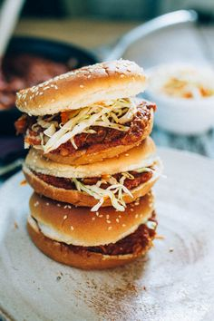 Vegan BBQ sandwiches made with shredded hearts of palm, homemade BBQ sauce and a crunchy apple cider vinegar coleslaw.