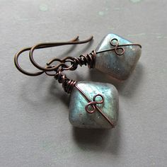 This site has so many cute wire wrappings for earrings!