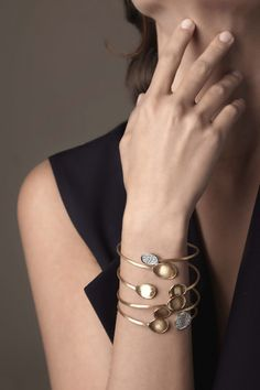 Love to Layer our Marco Bicego Lunaria and Diamond Lunaria bangles. www.marcobicego.com