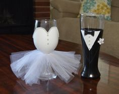 This hand painted bridal wine glass with tulle skirt and glitter is sure to make any bride feel extra special at her bridal shower,