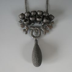 Tamara, Grüner Necklace: Chrysanthemen – In memoriam R. Lalique, 2009 Historical metal plate - blackened, various plastics, pigment, blacken...
