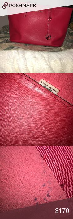 Michael Kors Tote Michael Kors Red Tote. A few small pen marks inside. (See pic) Size 14l x 11 1/2h. Drop strap 8inches. Made of saffiano leather. No marks on outside of bag. KORS Michael Kors Bags Totes