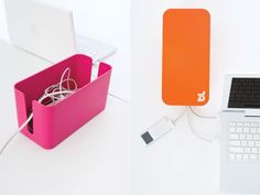CableBox Mini by BlueLounge.  Shove all your unsightly, tangly cords in the box and then put the top on and it looks much nicer.  This matters (to me at least).