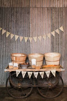 For a whimsical touch, a popcorn bar featuring different flavors does the trick. Place them in barrels on an old wagon cart for a rustic, autumnal feel.
