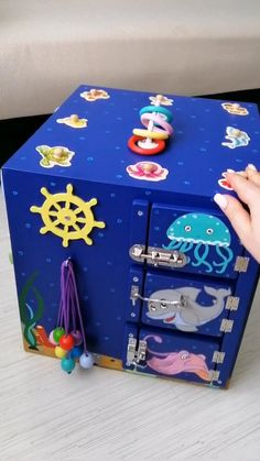 Busy board for 1 year old, Busy board toddler, Busy board for toddler boy, Sea creatures busy box Toddler Activity Board, Toddler Learning Activities, Montessori Activities, Infant Activities, Baby Sensory Play, Baby Play, Sensory Board For Babies, Sensory Boards, Toddler Toys