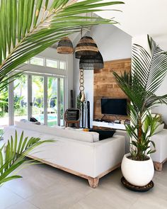 This living room has something exotic . The plants lamps and wooden wall make y… This living room has something exotic . The plants lamps and wooden wall make y… Febs Home And Living, Rustic Living Room Furniture, Modern Rustic Living Room, Interior Design, Home Remodeling, Home, Cheap Home Decor, Interior, Bali Style Home
