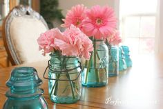 teal mason jars with pink flowers