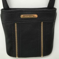 💯% authentic Michael Kors cross body bag NWOT super soft black leather with zipper detail in the front. Never been used. Measurements 7.5in along the bottom and 8.5in from top to bottom. Michael Kors Bags Crossbody Bags