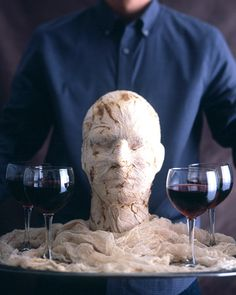 can make the head out of paper mache and just put creepy material around him. maybe bowls of candy
