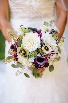 Proof that casual can still be breathtaking: a hand-tied bouquet of dalias, calla lilies and bright greens.