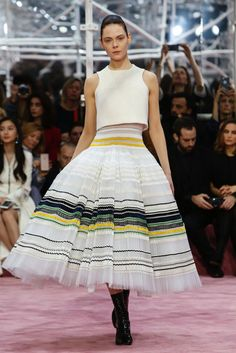 03.30.15 Again Dior takes us back to the 1947 New Look with a very exaggerated full skirt and a more fitted top.