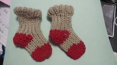 Check out this item in my Etsy shop https://www.etsy.com/listing/251145993/pair-of-baby-socks-khaki-gray-and-red