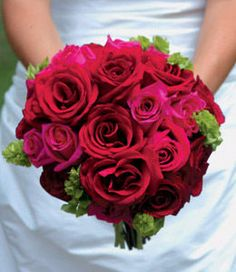 Thought you might like a peek at this.  Another red and hot pink rose bouquet with a touch of green.