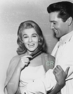 Elvis obviously in a close clench with Ann Margret. He really loved her!
