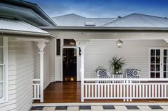 Highly polished timber deck goes beautifully iwth the white and grey exterior colours of the home. Highgate House – Brisbane based interior designers and decorators Weatherboard Exterior, Grey Exterior, Exterior Colors, Exterior Design, Interior And Exterior, Exterior Paint, Building Exterior, House Building, Veranda Railing