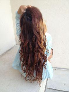 Auburn hair with blonde highlight , curled hair.