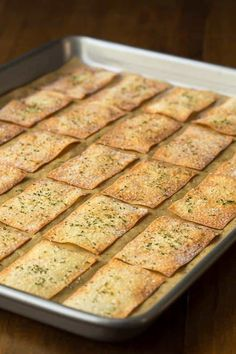 Ridiculously Easy Olive Oil Rosemary Crackers is part of Cracker recipes - With just three ingredients and no mixing, kneading or rolling, these Ridiculously Easy Olive Oil Rosemary Crackers take 15 minutes from start to finish! Savory Snacks, Healthy Snacks, Healthy Crackers, Gluten Free Crackers, Eating Healthy, Bon Dessert, Dessert Bread, Vegan Recipes, Cooking Recipes